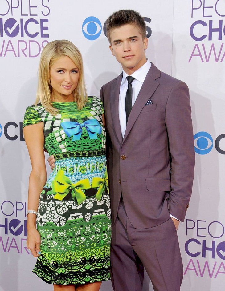 Image Credits: Getty Images / Gregg DeGuire / WireImage | Actress Paris Hilton and model River Viiperi arrive at the 2013 People's Choice Awards at Nokia Theatre L.A. Live on January 9, 2013 in Los Angeles, California.