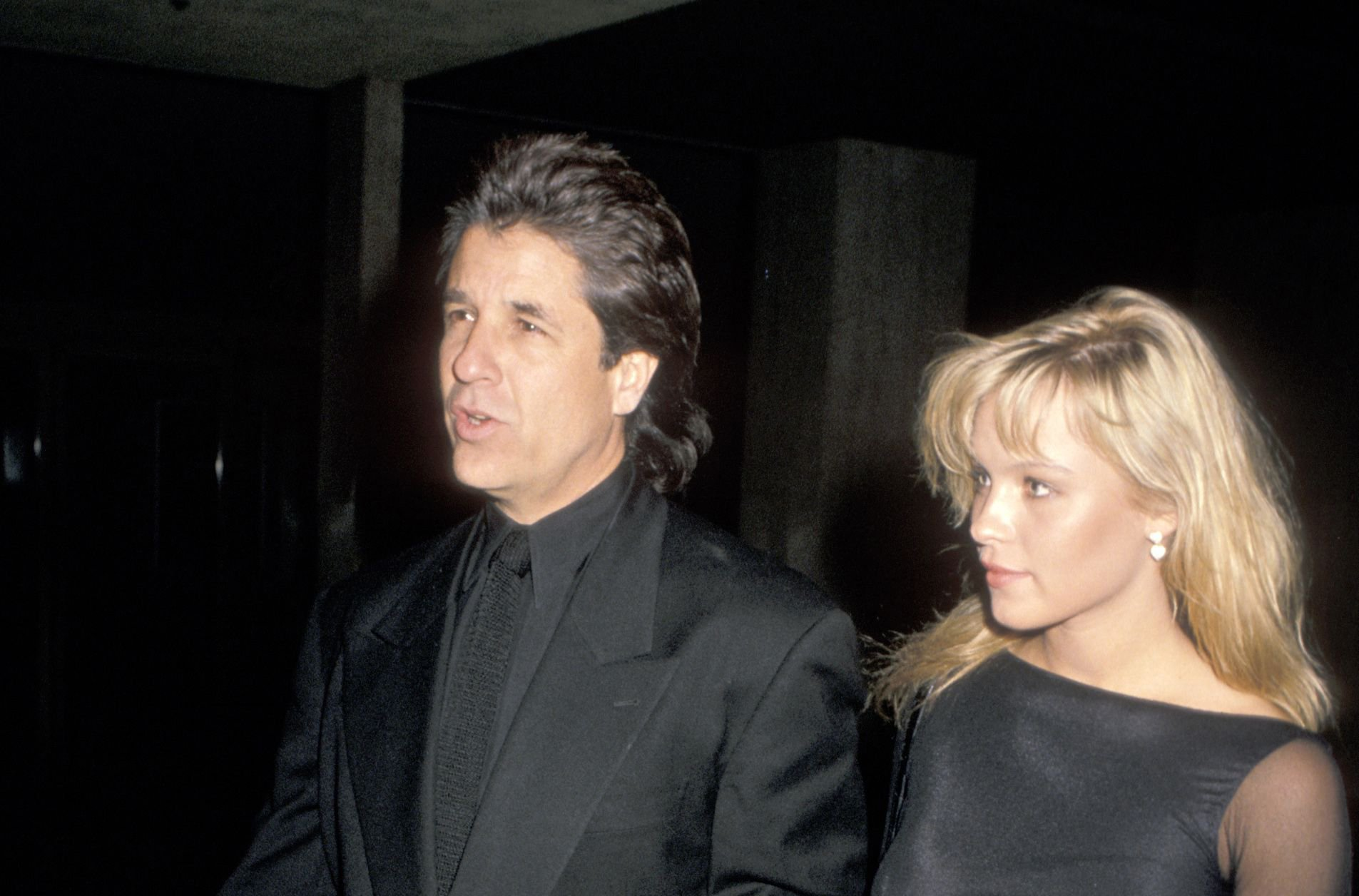 Jon Peters and Pamela Anderson attend the premiere of 'Glory' on December 11, 1989 / Getty Images