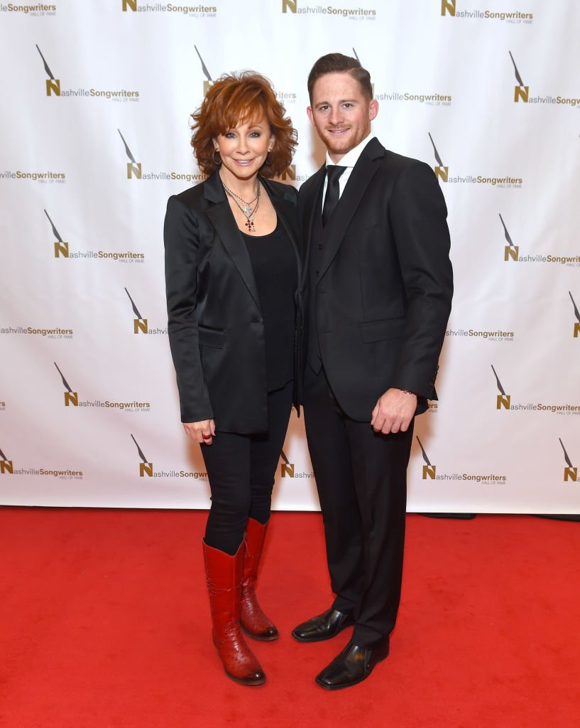 Image Credits: Getty Images / Jason Kempin | Reba and her son Shelby Blackstock