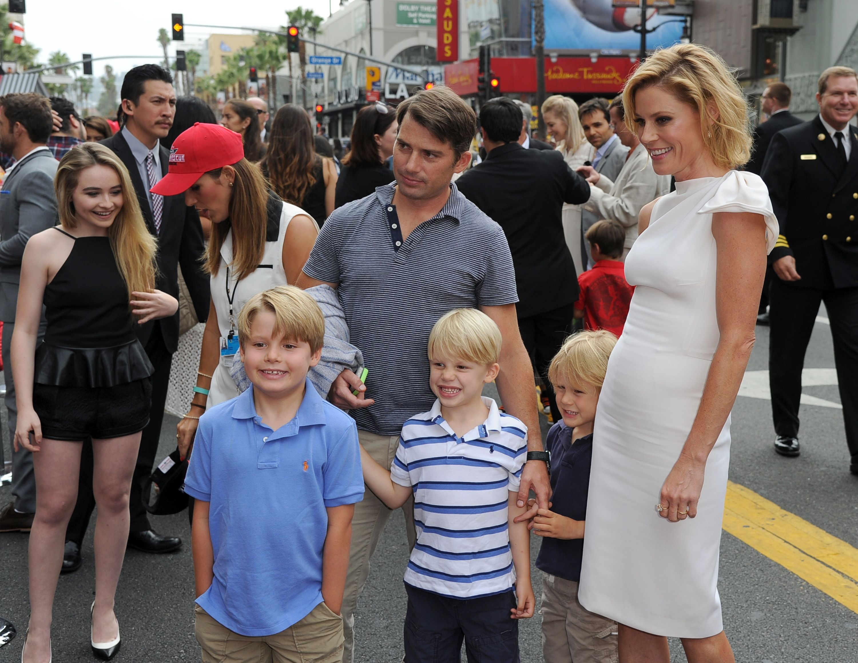 "Actress Julie Bowen and family attend the premiere of Disney's ""Planes: Fire & Rescue"" / Getty Images"