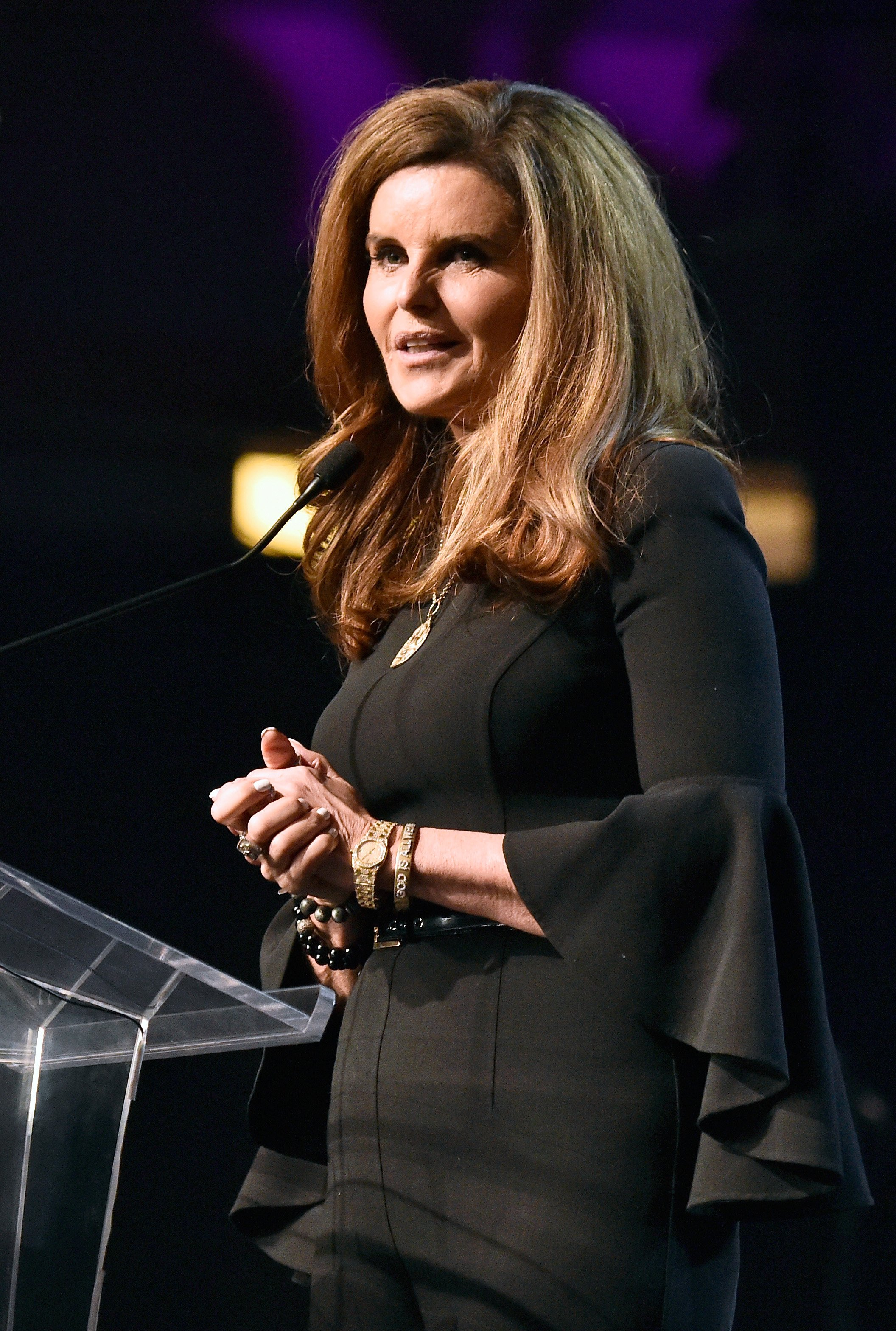 Image Credits: Getty Images / Frazer Harrison | Honoree Maria Shriver speaks onstage at Celebrity Fight Night XXIV on March 10, 2018 in Phoenix, Arizona.