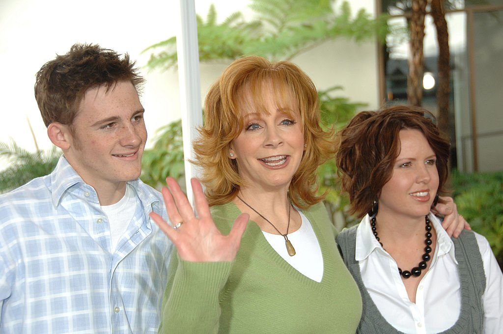 Image Credits: Getty Images / Frank Trapper/Corbis | Reba and her son Shelby and stepdaughter Chassidy