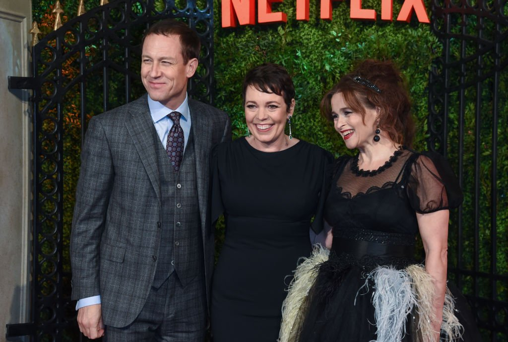 "Image Credits: Getty Images / David M. Benett / WireImage | Tobias Menzies, Olivia Colman and Helena Bonham Carter attend the World Premiere of Netflix Original Series ""The Crown"" Season 3 at The Curzon Mayfair on November 13, 2019 in London, England."