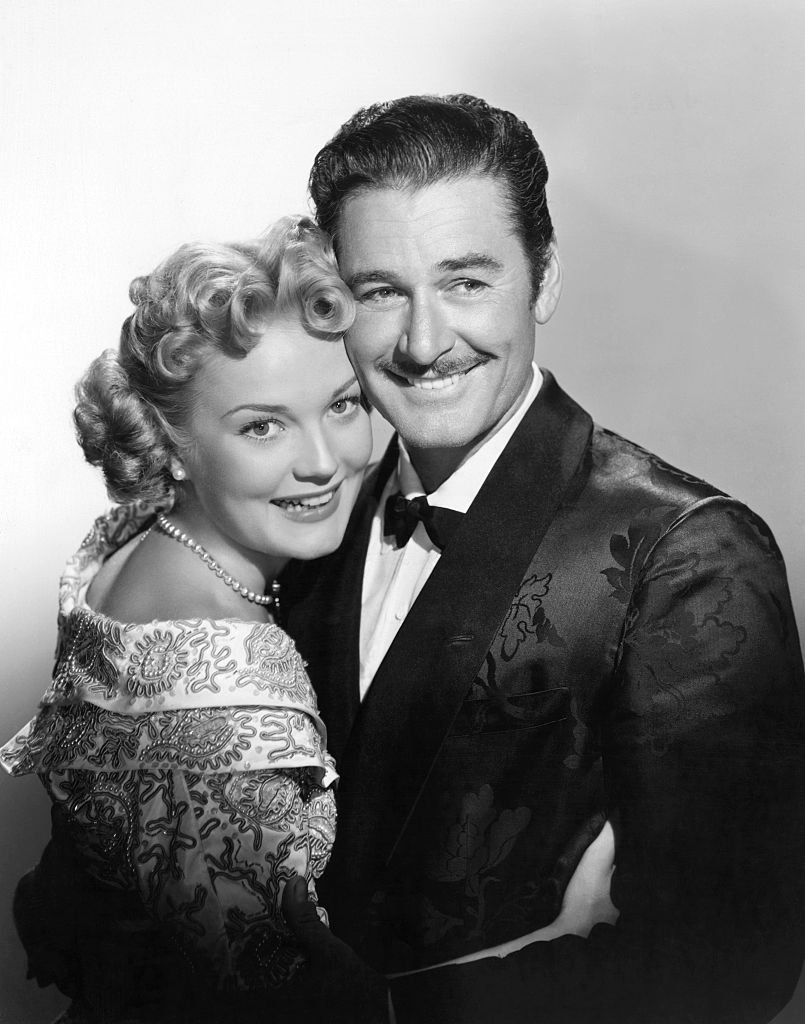 Image Source: Getty Images/Bettmann/Errol Flynn, swashbuckling hero of the motion picture screen, engages in a passionate love scene with Patrice Wymore during the filming of one of their pictures.