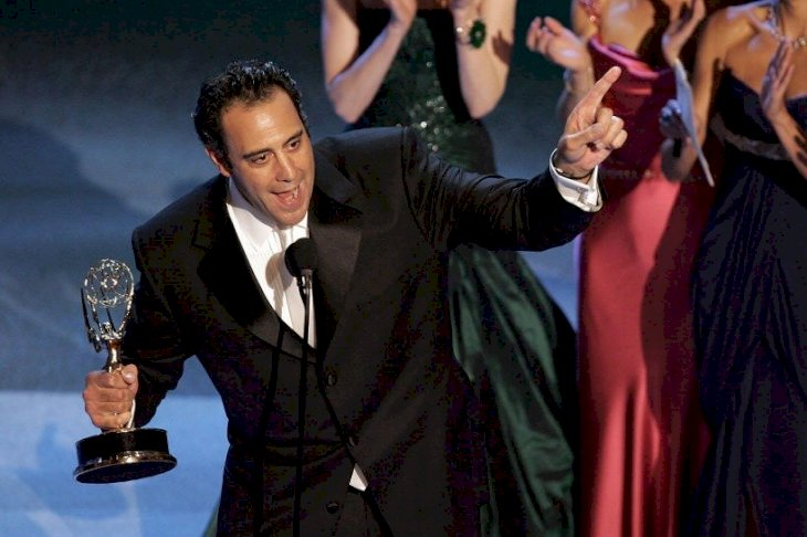 """Image Credits: Getty Images / Actor Brad Garrett accepts the award for Best Supporting Actor in a Comedy Series for """"Everybody Love Raymond"""" onstage"""