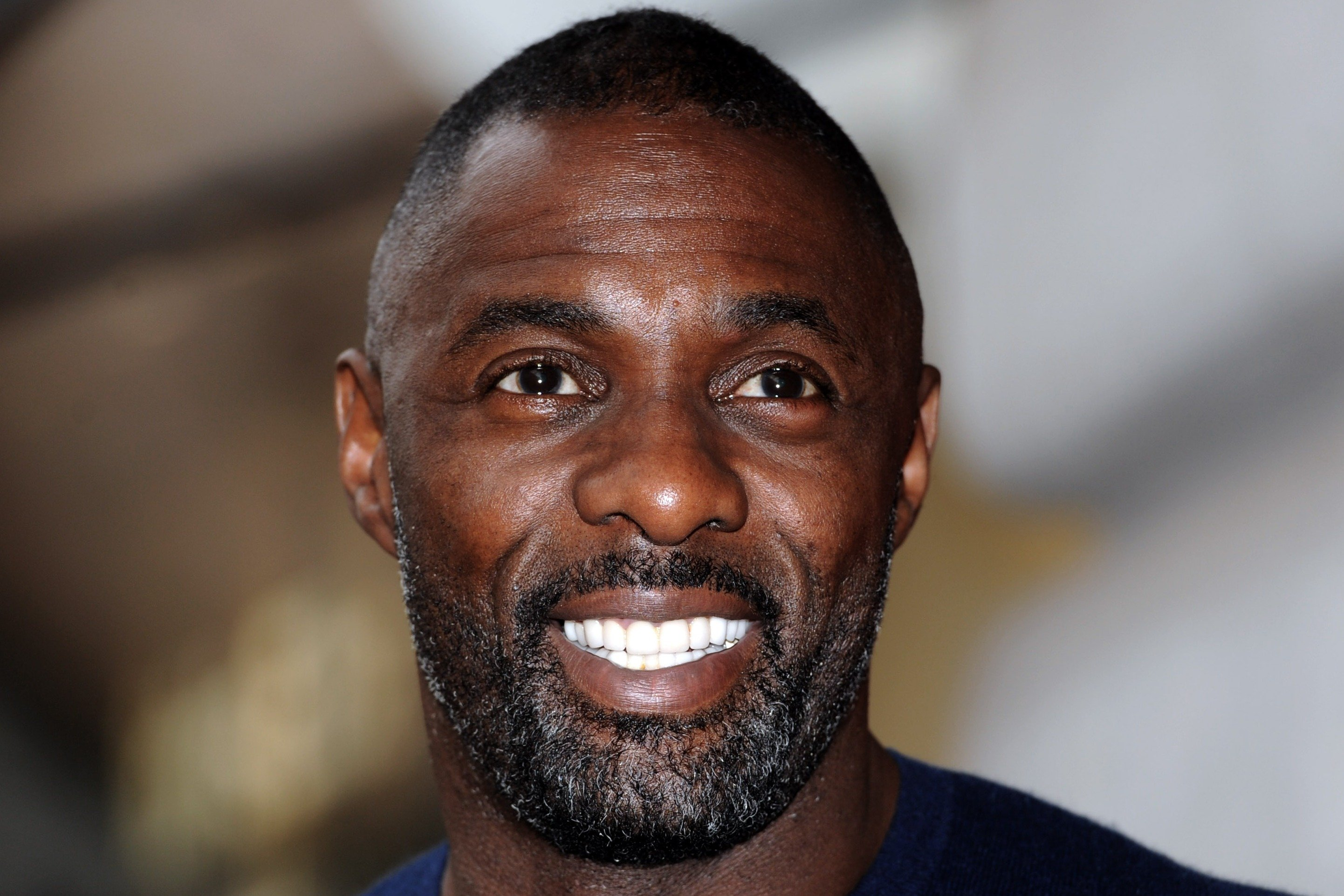 Image Credit: Getty Images/Stuart C. Wilson |  Idris Elba attends a photocall to launch the Superdry AW15 Premium Menswear collection