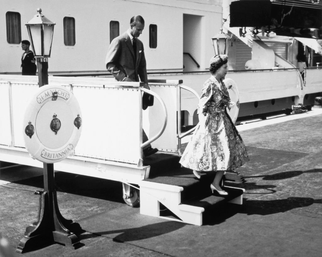 Image Source: Getty Images/National Film Board of Canada/View of Queen Elizabeth II and Prince Philip, Duke of Edinburgh, as they disembark the Royal Yacht Britannia during their voyage to inland Canada