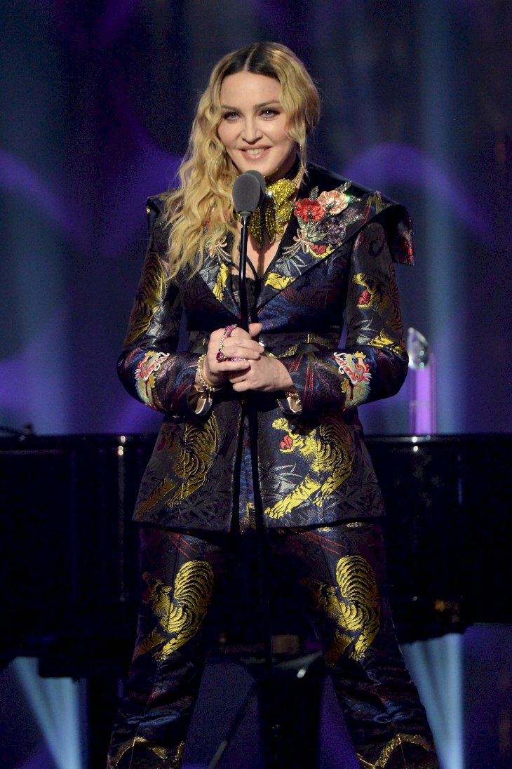 Image Credit: Getty Images/Getty Images for Billboard Magazine/Kevin Mazur |Madonna speaks on stage at the Billboard Women in Music 2016