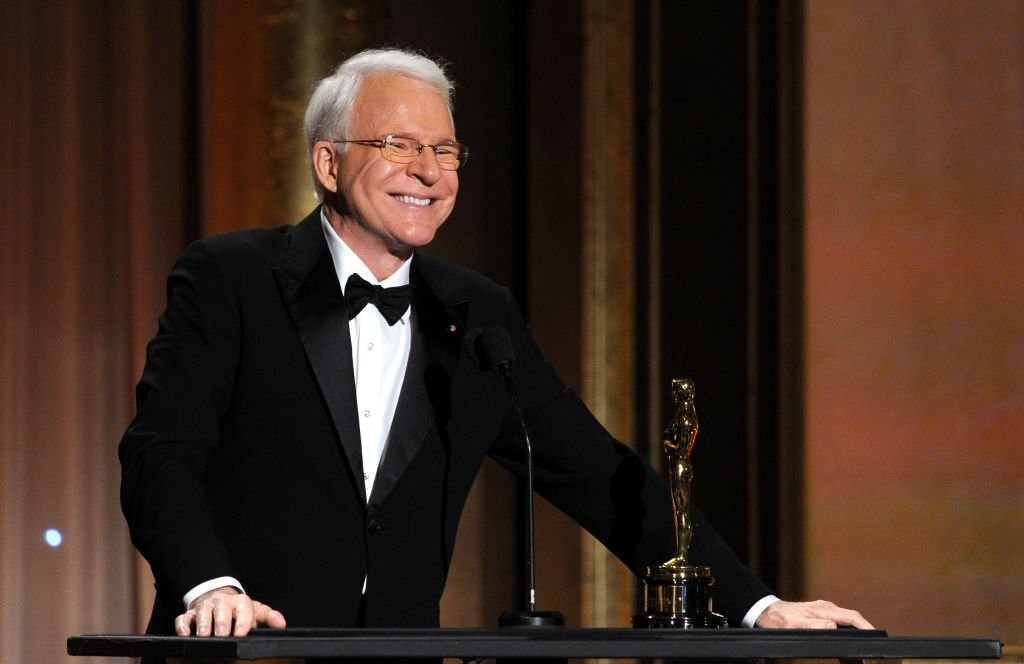 Image Credits: Getty Images / Kevin Winter   Honoree Steve Martin accepts honorary award onstage during the Academy of Motion Picture Arts and Sciences' Governors Awards at The Ray Dolby Ballroom at Hollywood & Highland Center on November 16, 2013 in Hollywood, California.