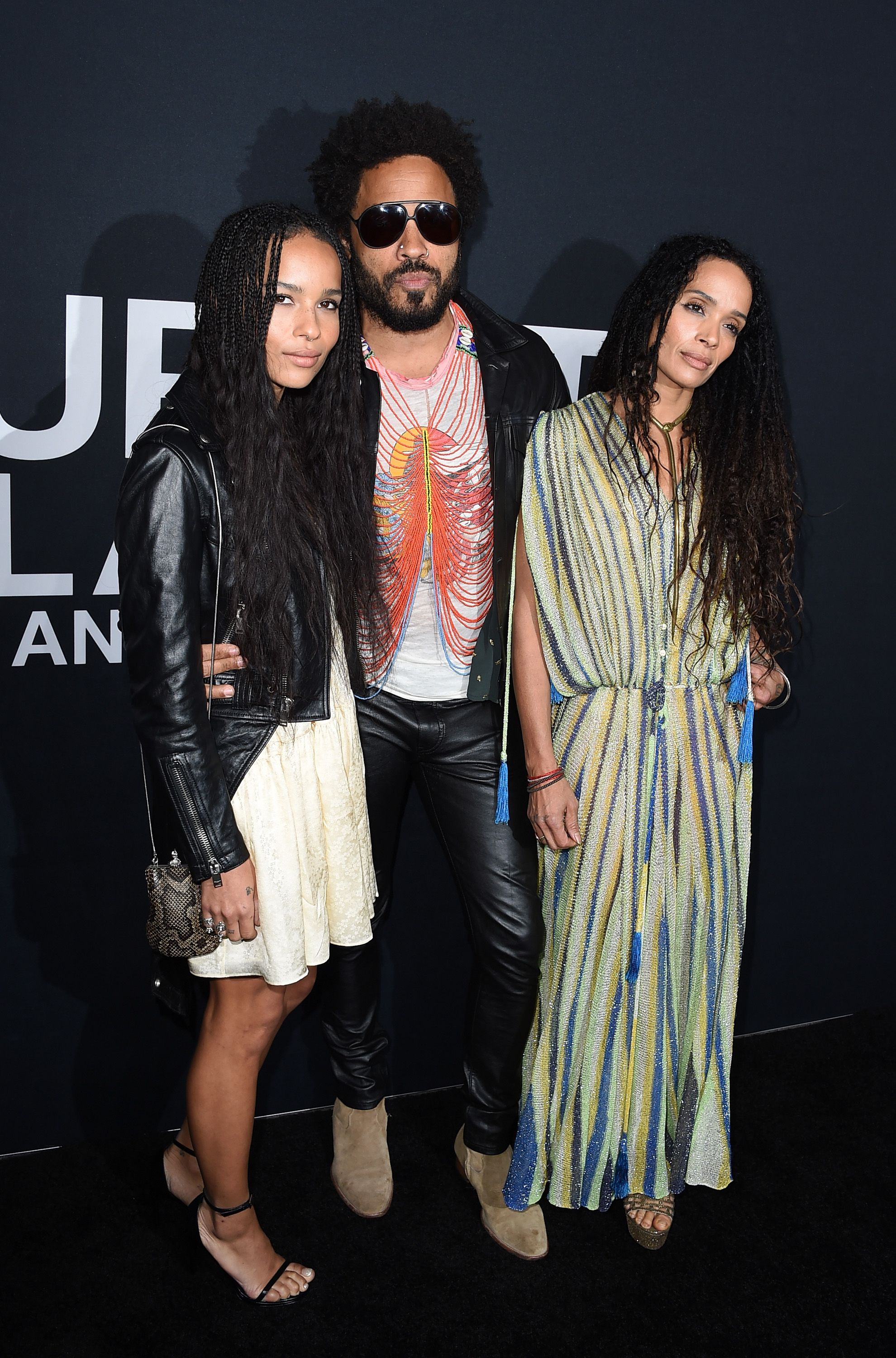 Musician Lenny Kravitz and actresses Zoe Kravitz and Lisa Bonet attend the Saint Laurent show / Getty Images