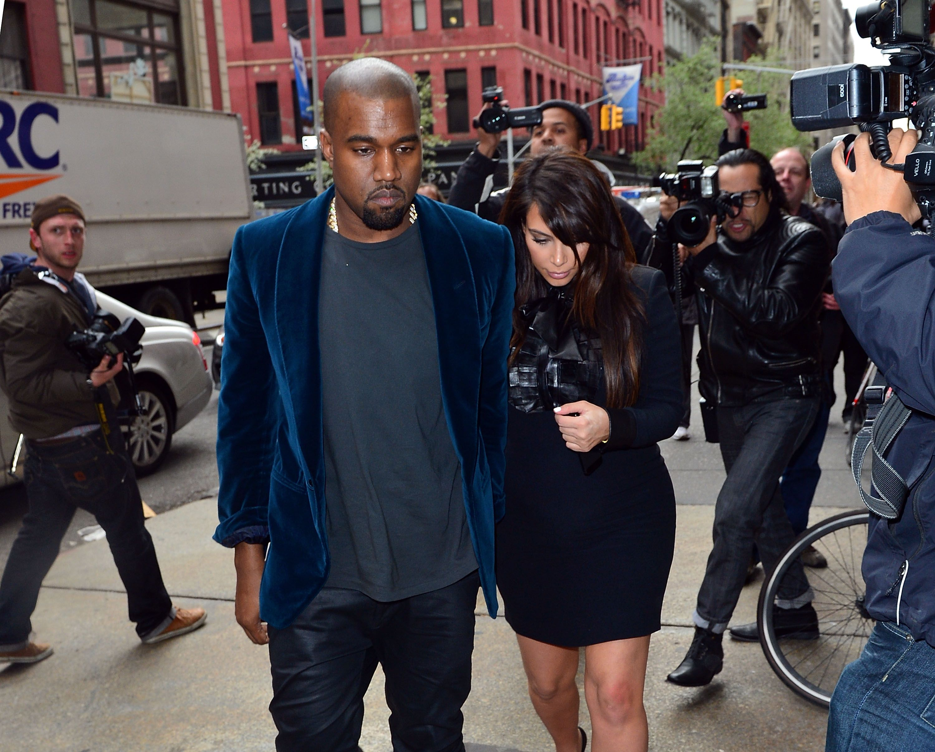 Kanye West and Kim Kardashian / Getty Images