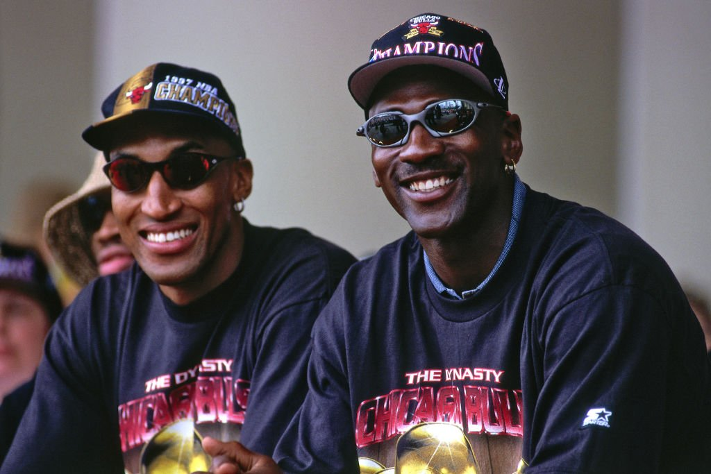 Image Credits: Getty Images / Steve Woltman / NBAE | Scottie Pippen #33, and Michael Jordan #23 of the Chicago Bulls are seen smiling at the Chicago Bulls Championship Parade and Rally on June 16, 1997 at Grant Park in Chicago, Illinois.