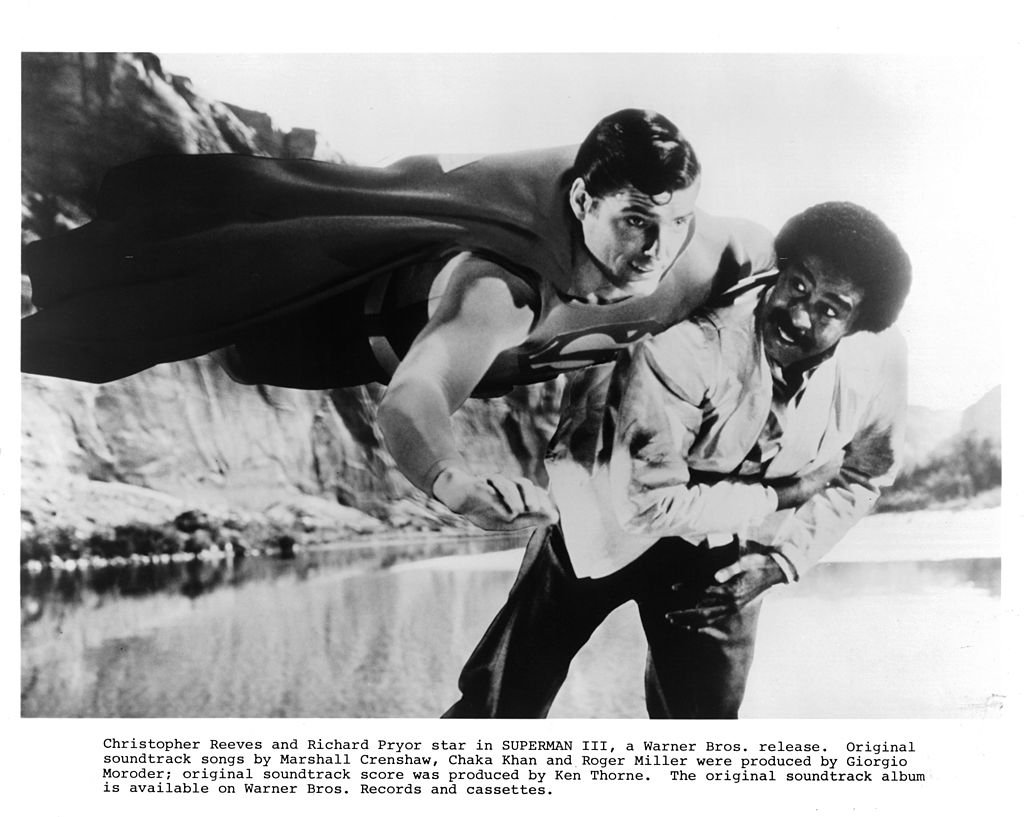 "Image Credits: Getty Images / Michael Ochs Archives | Christopher Reeve and Richard Pryor in a scene from the Warner Bros. movie ""Superman III,  1983"