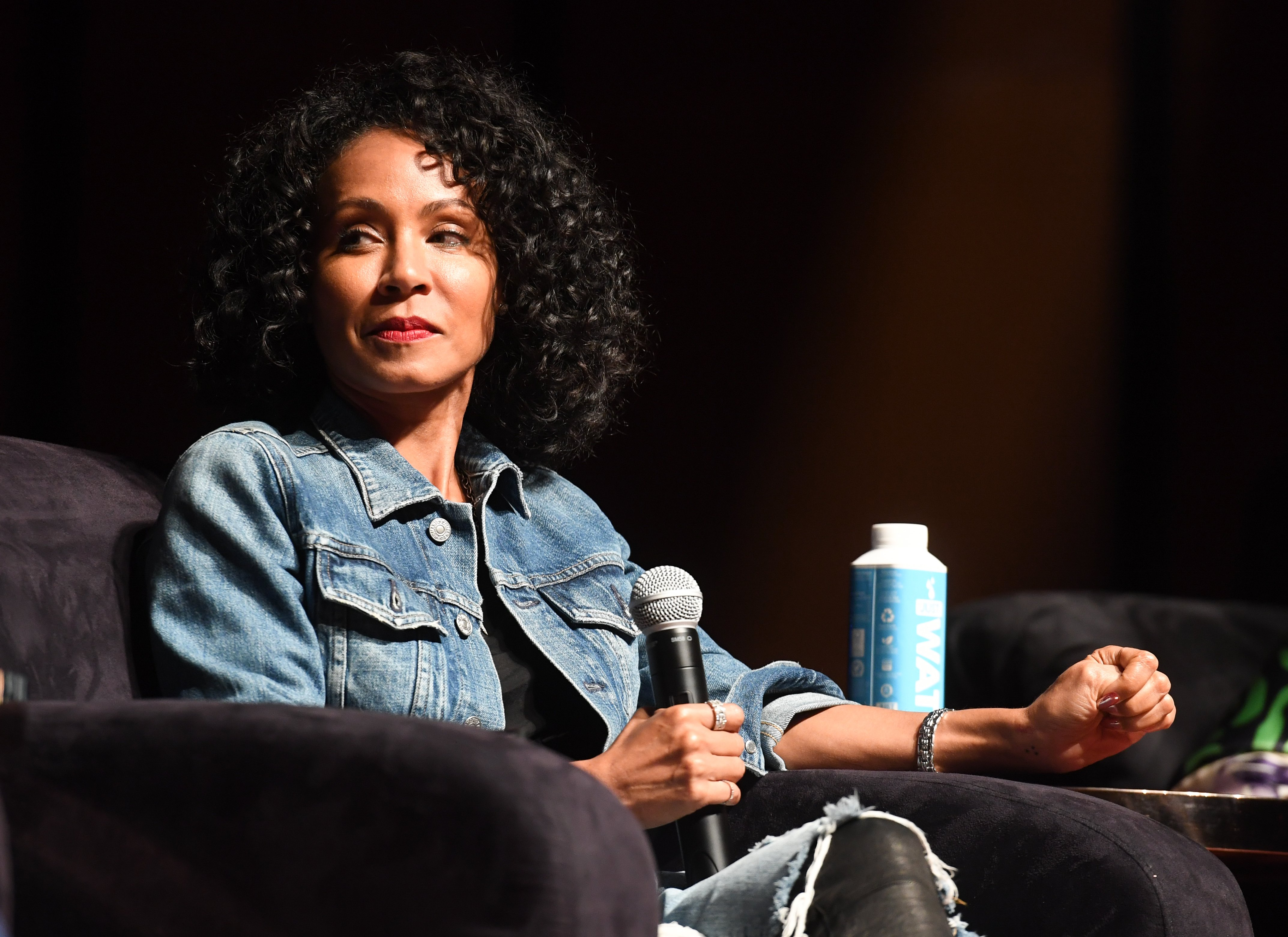 Image Credits: Getty Images / Paras Griffin | Actress Jada Pinkett Smith speaks onstage at Careers In Entertainment Tour - Atlanta at Morehouse College on October 20, 2017 in Atlanta, Georgia.