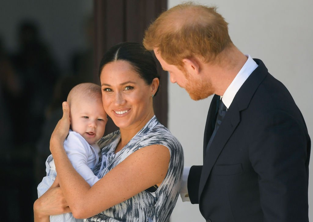 Image Source: Getty Images/Prince Harry and Meghan Markle with their child