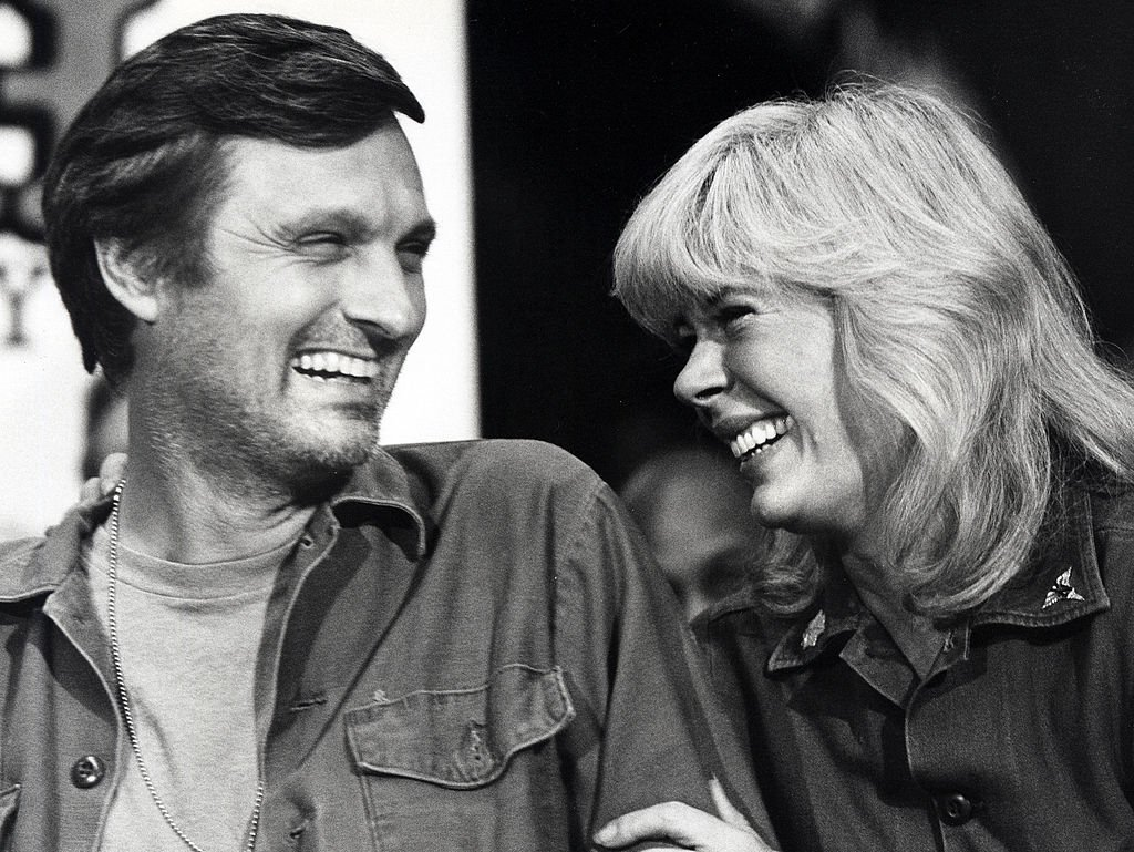 "Image Credits: Getty Images / Ron Galella/Ron Galella Collection | Alan Alda and Loretta Swit during Press Conference for the Final Taping of ""M*A*S*H*"" - January 14, 1983"