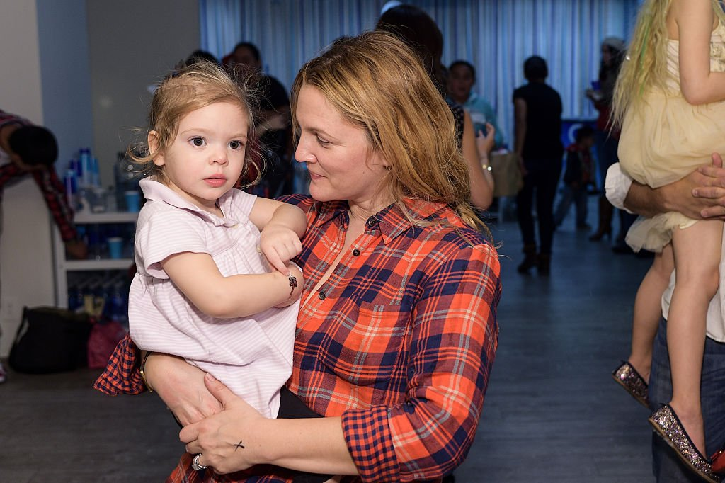 Image Credits: Getty Images / Stefanie Keenan | Drew Barrymore and daughter attend Baby2Baby Holiday Party Presented By The Honest Company at Baby2Baby Headquarters on December 13, 2014 in Los Angeles, California.