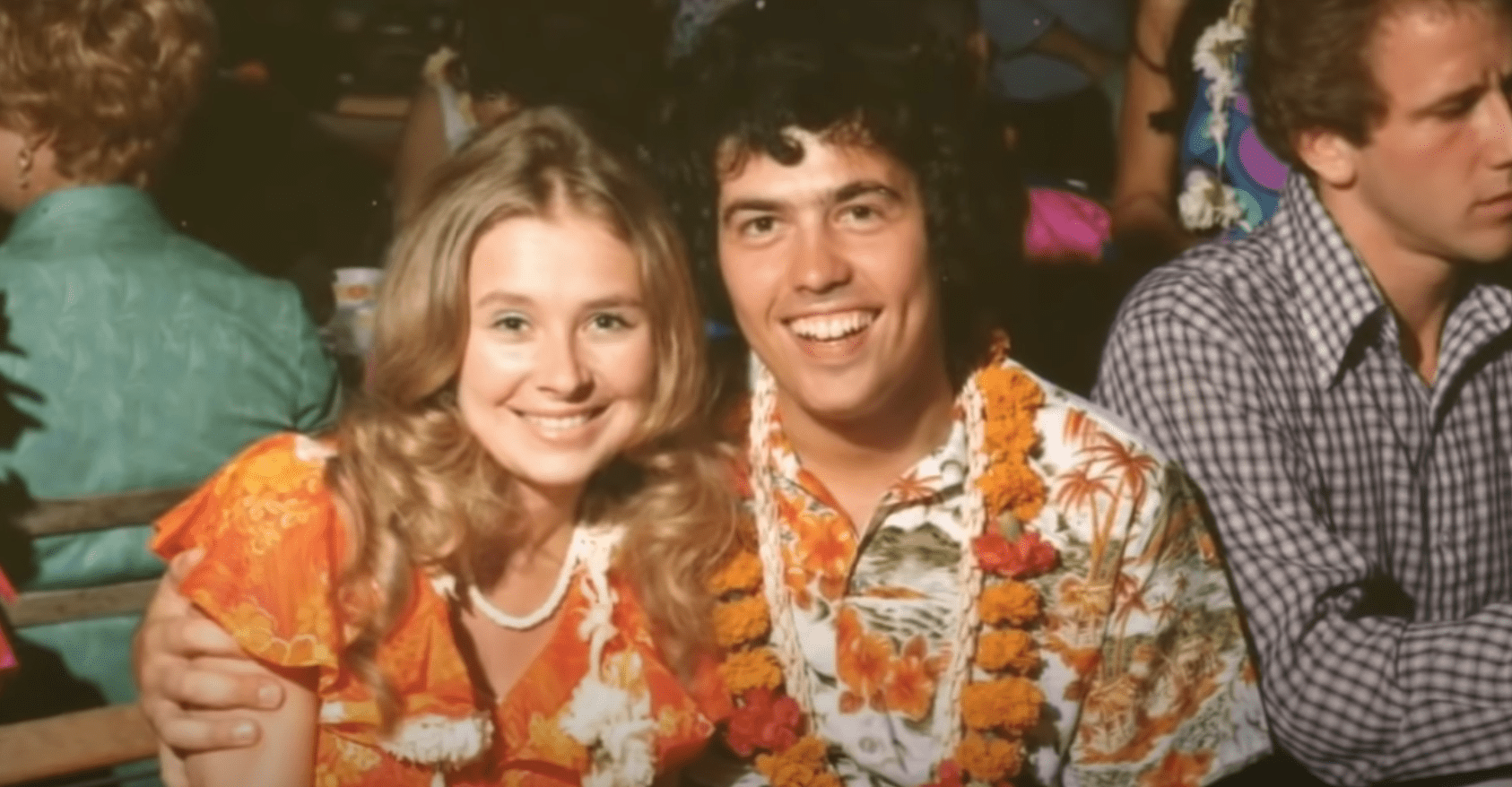 Image Source:Youtube/Nathan Osmond| Nathan and wife Suzanne in Hawaiian outfits