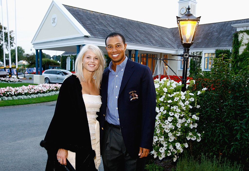 Image Credit: Getty Images /  Tiger Woods of USA poses with his wife Elin Nordegren at The Welcome Dinner after the first official practice day of the 2006 Ryder Cup at The K Club on September 19, 2006.
