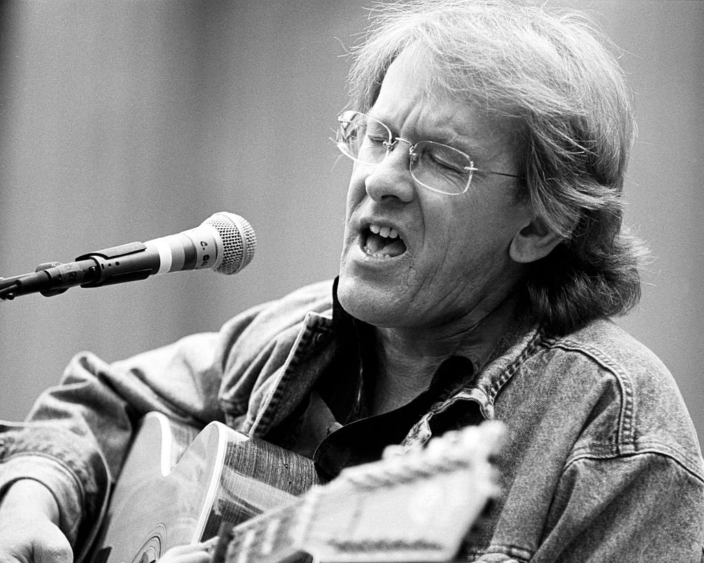 Image Credits: Getty Images / Clayton Call / Redferns | Paul Kantner performs as part of the Bread & Roses Festival at the Greek Theater in Berkeley, CA on September 21, 1991.