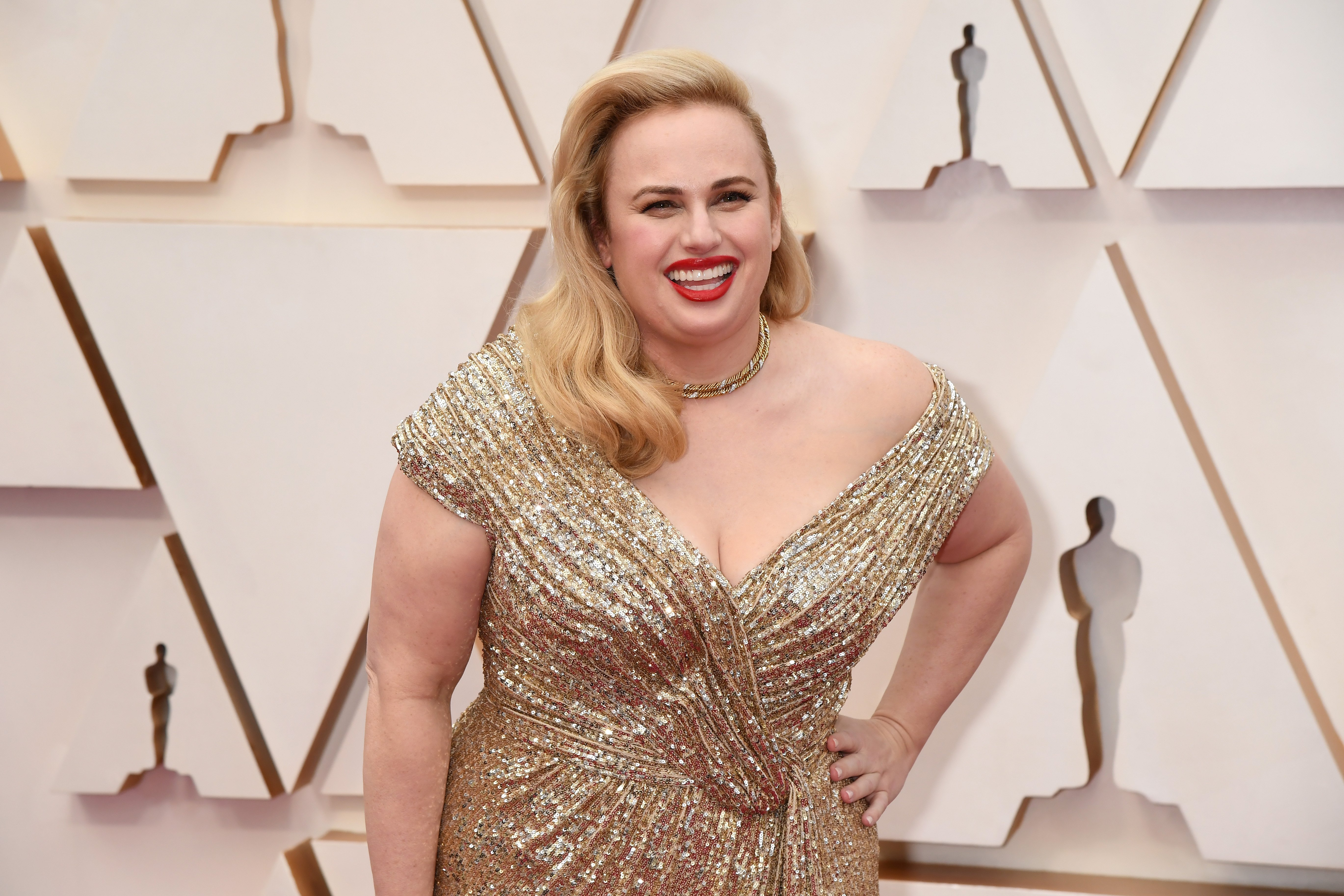 Image Credit: Getty Images/FilmMagic/Jeff Kravits | Rebel Wilson attends the 92nd Annual Academy Awards at Hollywood and Highland