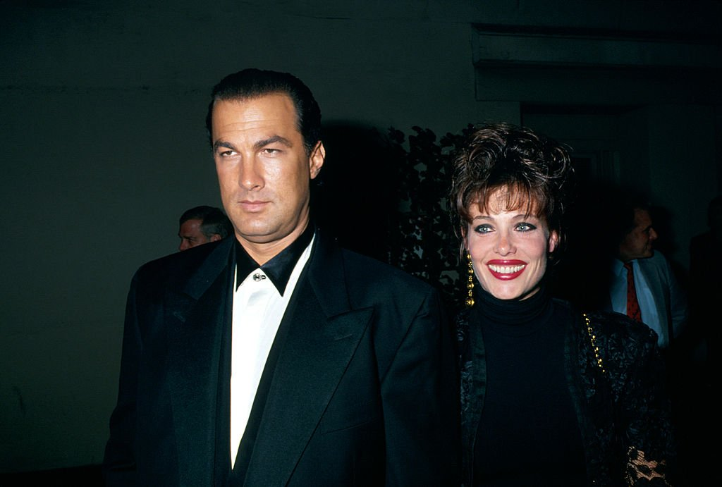 Image Credits: Getty Images / Kevin Winter / DMI / The LIFE Picture Collection | Married actors Steven Seagal and Kelly LeBrock.