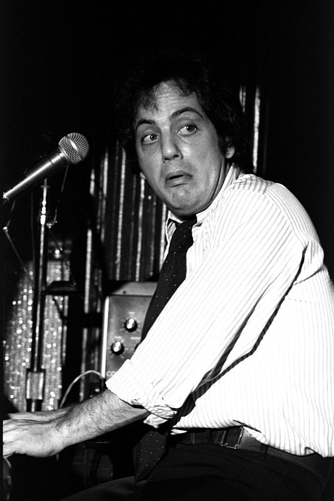 Image Credits: Getty Images / Richard E. Aaron / Redferns | Billy Joel performs live on stage at the Bottom Line Club in New York in 1976.