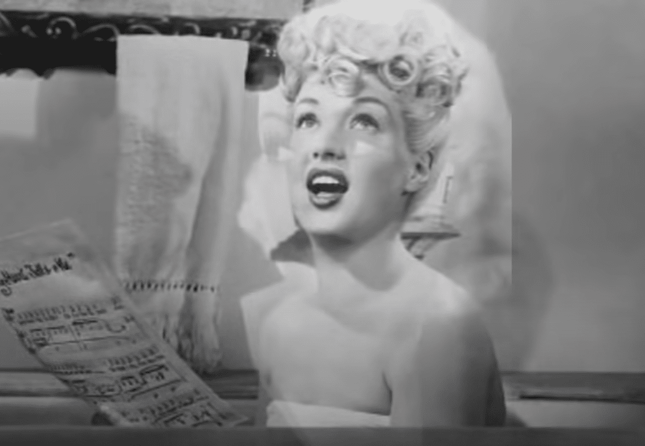 Image Source: Youtube/Stacey|Betty singing in one of her shows