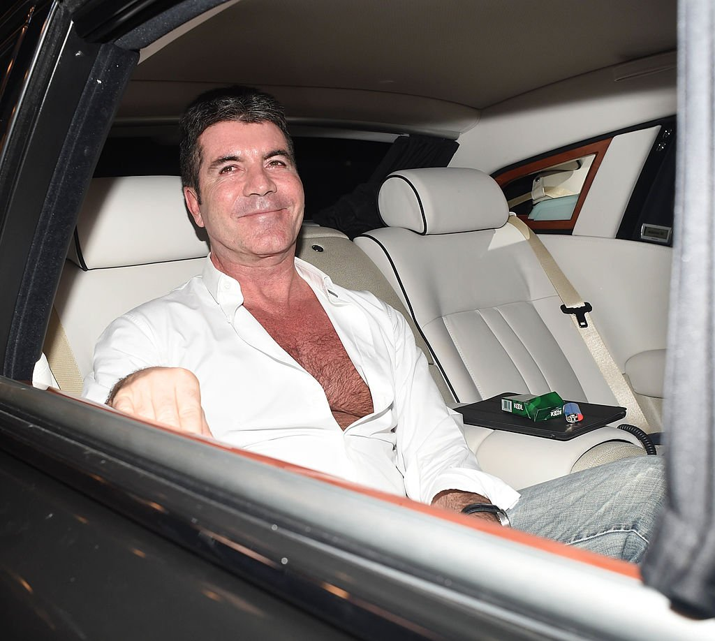 Image Credit: Getty Images / Simon Cowell seen leaving the Dorchester hotel after a day full of meetings and a special apperance at a charity event held at the hotel on April 1, 2014 in London, England.