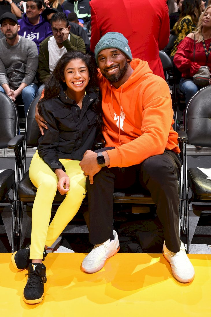 Image Credits: Getty Images / Andrew D. Bernstein / NBAE | Kobe Bryant and Gianna Bryant attend the game between the Los Angeles Lakers and the Dallas Mavericks on December 29, 2019 at STAPLES Center in Los Angeles, California.