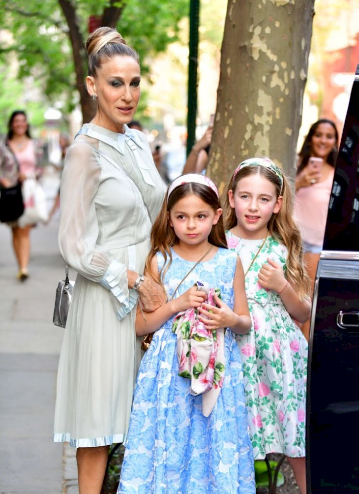 Image Credits: Getty Images / James Devaney / GC Images | Sarah Jessica Parker, Tabitha Broderick and Marion Loretta Broderick seen on the streets of Manhattan on May 3, 2018 in New York City.