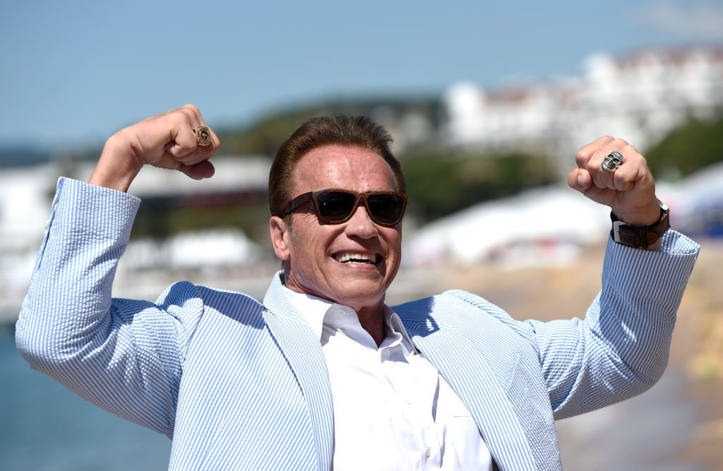 Image Credits: Getty Images / Antony Jones | Arnold Schwarzenegger attends photocall for 'Wonders of the Sea 3D' during the 70th annual Cannes Film Festival at Nikki Beach on May 20, 2017 in Cannes, France.