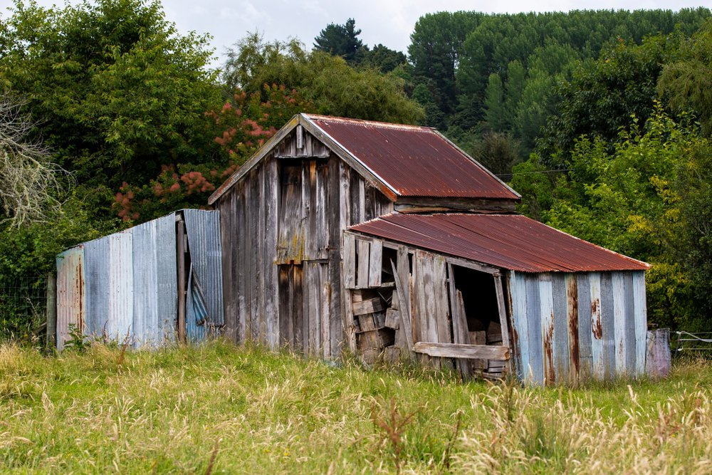An abandoned shed on a farm | Shutterstock