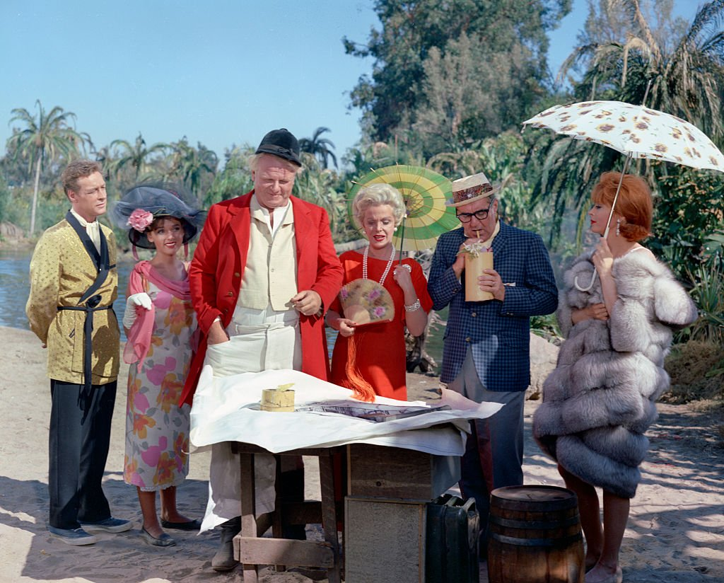Image Credit: Getty Images / Filmed at the lagoon, CBS Studio Center, Studio City, CA. Image date, March 3, 1964. Original broadcast date October 3, 1964. Pictured from left is Russell Johnson (as Professor Roy Hinkley), Dawn Wells (as Mary Ann Summers), Alan Hale Jr. (as Jonas 'The Skipper' Grumby), Natalie Schafer (as Mrs. Lovey Howell), Jim Backus (as Thurston Howell III), Tina Louise (as Ginger).
