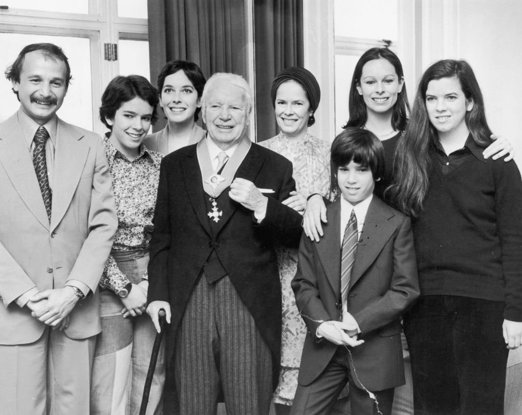 Image Source: Getty Images/Aubrey Hart/Comic actor Charlie Chaplin (1889 - 1977) with his wife Oona O'Neill (1925 - 1991) and family at the Savoy Hotel, London after Chaplin received his knighthood at Buckingham Palace, 4th March 1975