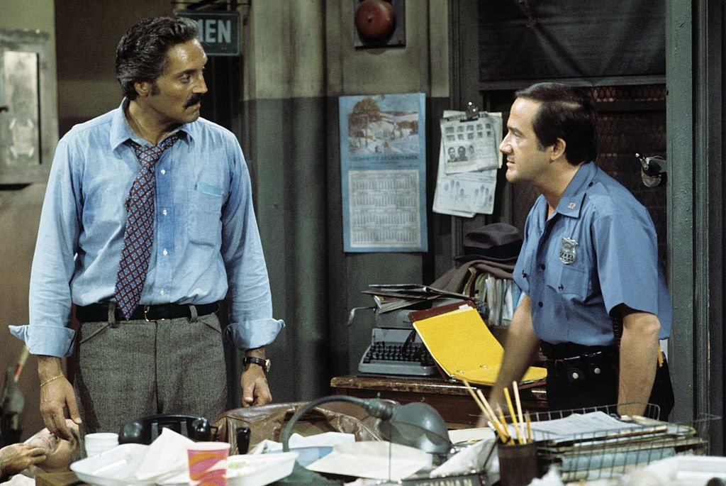 Image Credit: Getty Images / Hal Linden, Ron Carey on set for Barney Miller.
