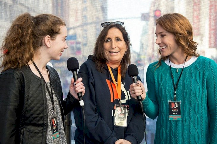 Image Credit: Getty Images/Emma McIntyre | Deena Katz in an interview at the women's march in Los Angeles