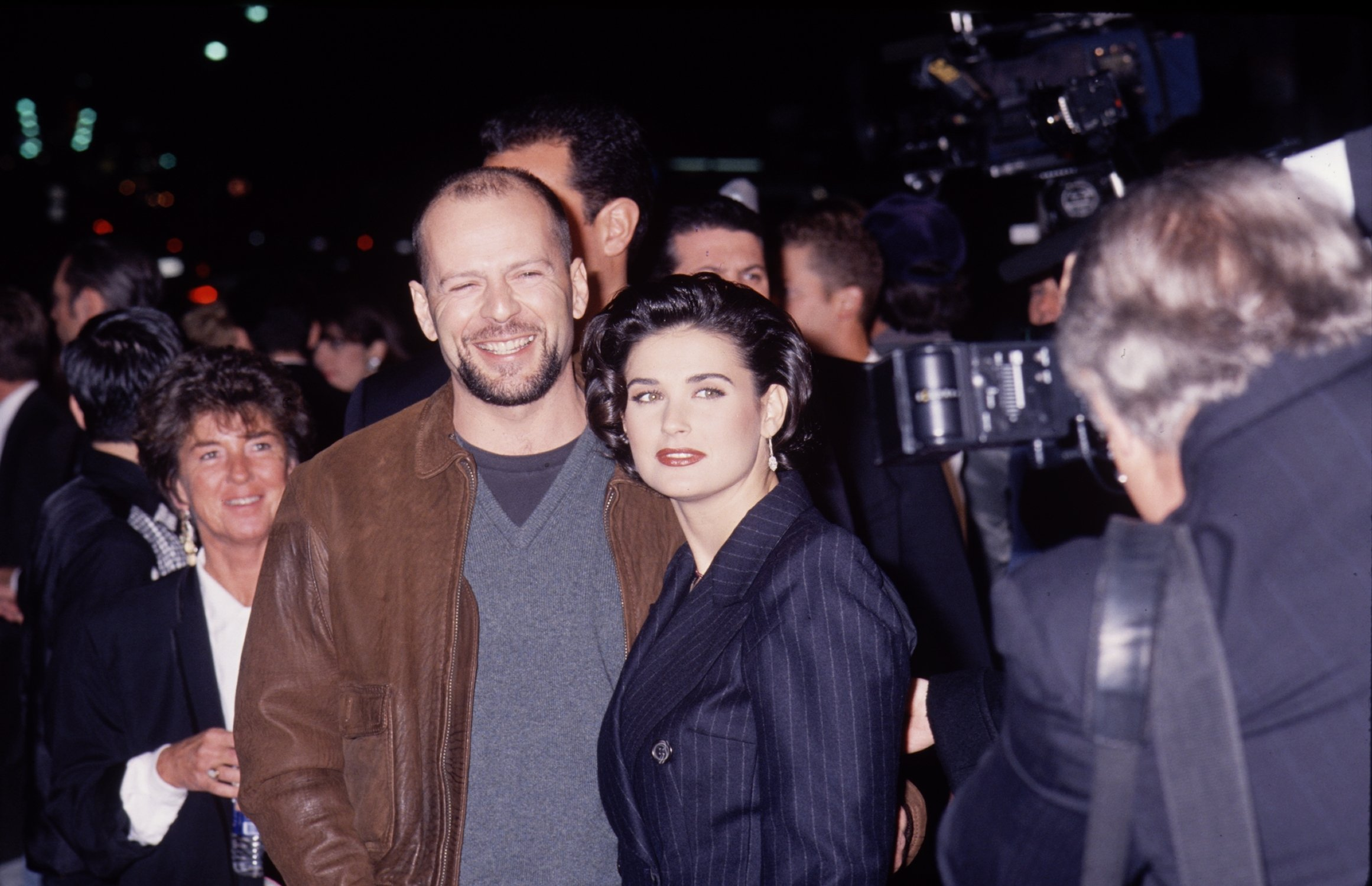 Image Sources: Getty Images/Bruce Willis and Demi Moore together for an event