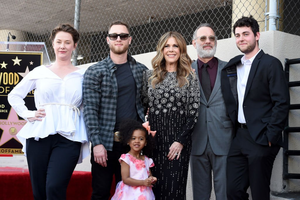 Image Credits: Getty Images / Axelle / Bauer-Griffin / FilmMagic | Chet Hanks (2L), Rita Wilson, Tom Hanks and Truman Hanks attend the ceremony honoring Rita Wilson with Star on the Hollywood Walk of Fame on March 29, 2019 in Hollywood, California.