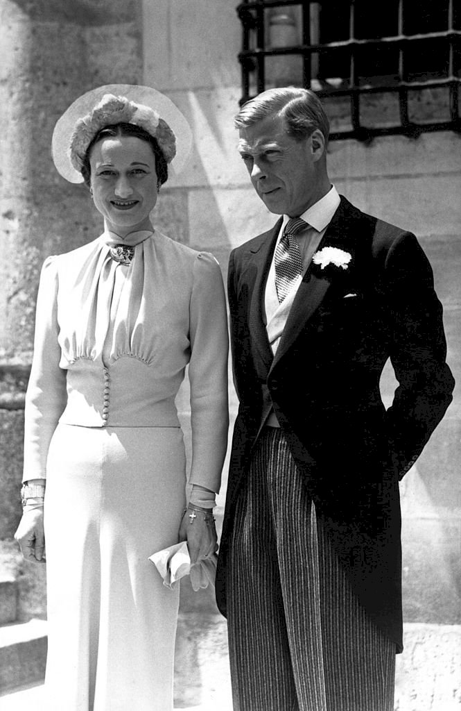 Image Credits: Getty Images / Mondadori | Edward VIII and Wallis Simpson posing at the Castle of Conde on their wedding day.