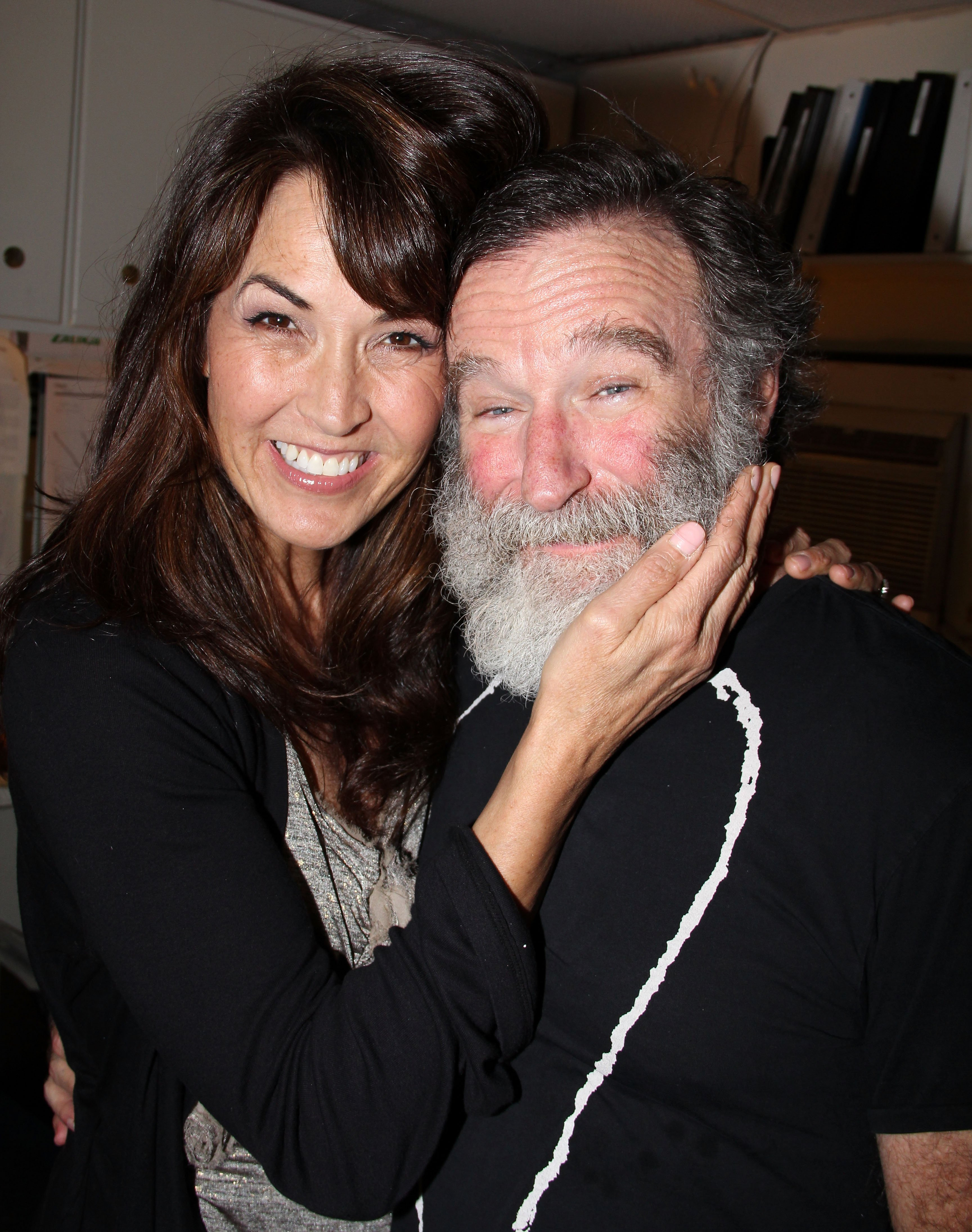 "Image Credits: Getty Images / Bruce Glikas / FilmMagic | Susan Schneider and fiancee Robin Williams pose backstage at the hit play ""Bengal Tiger at The Baghdad Zoo"" on Broadway at The Richard Rogers Theater on June 15, 2011 in New York City."