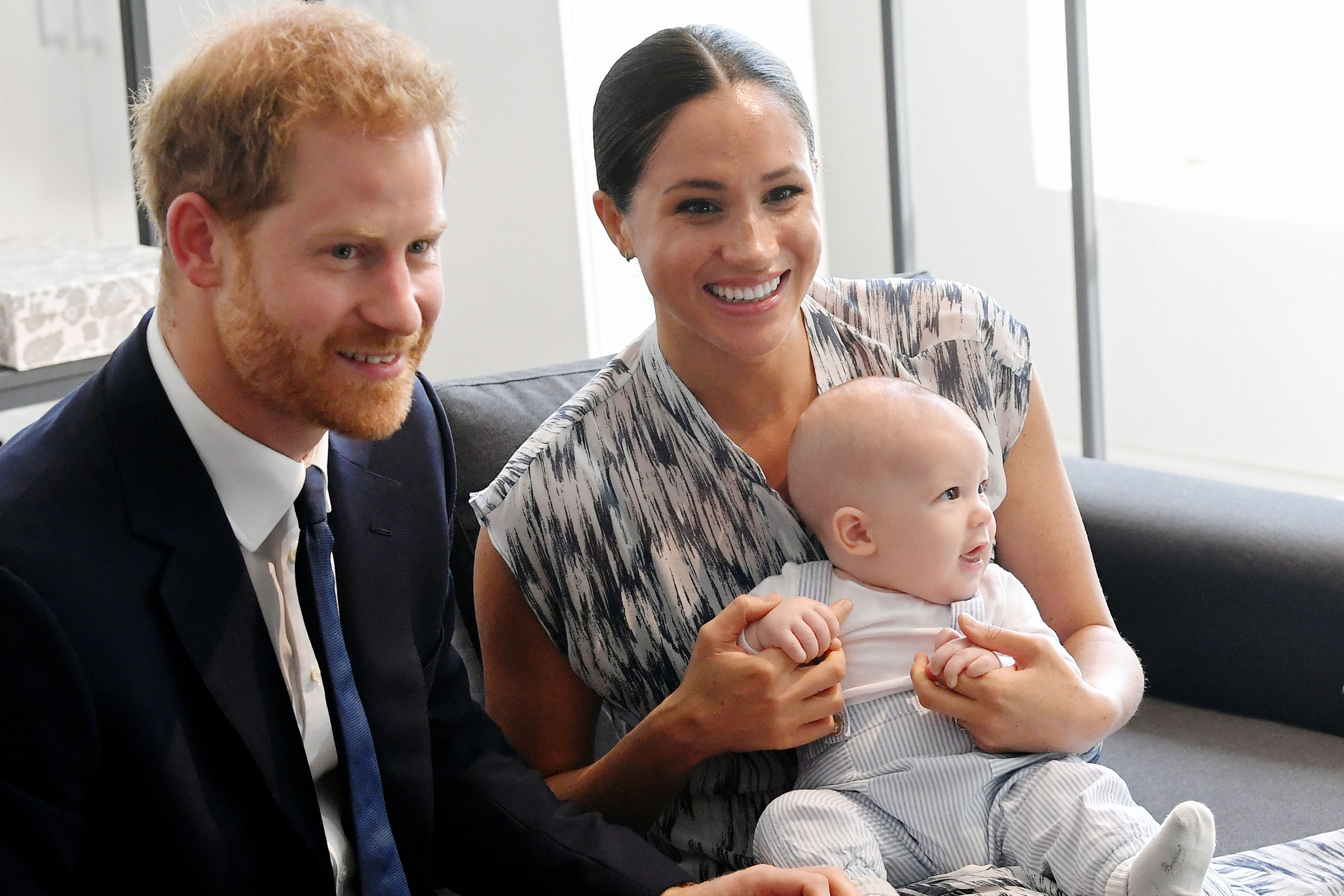 Prince Harry, Meghan, and their baby son Archie Mountbatten-Windsor meet Archbishop Desmond Tutu during their royal tour of South Africa in 2019/Photo:Getty Images