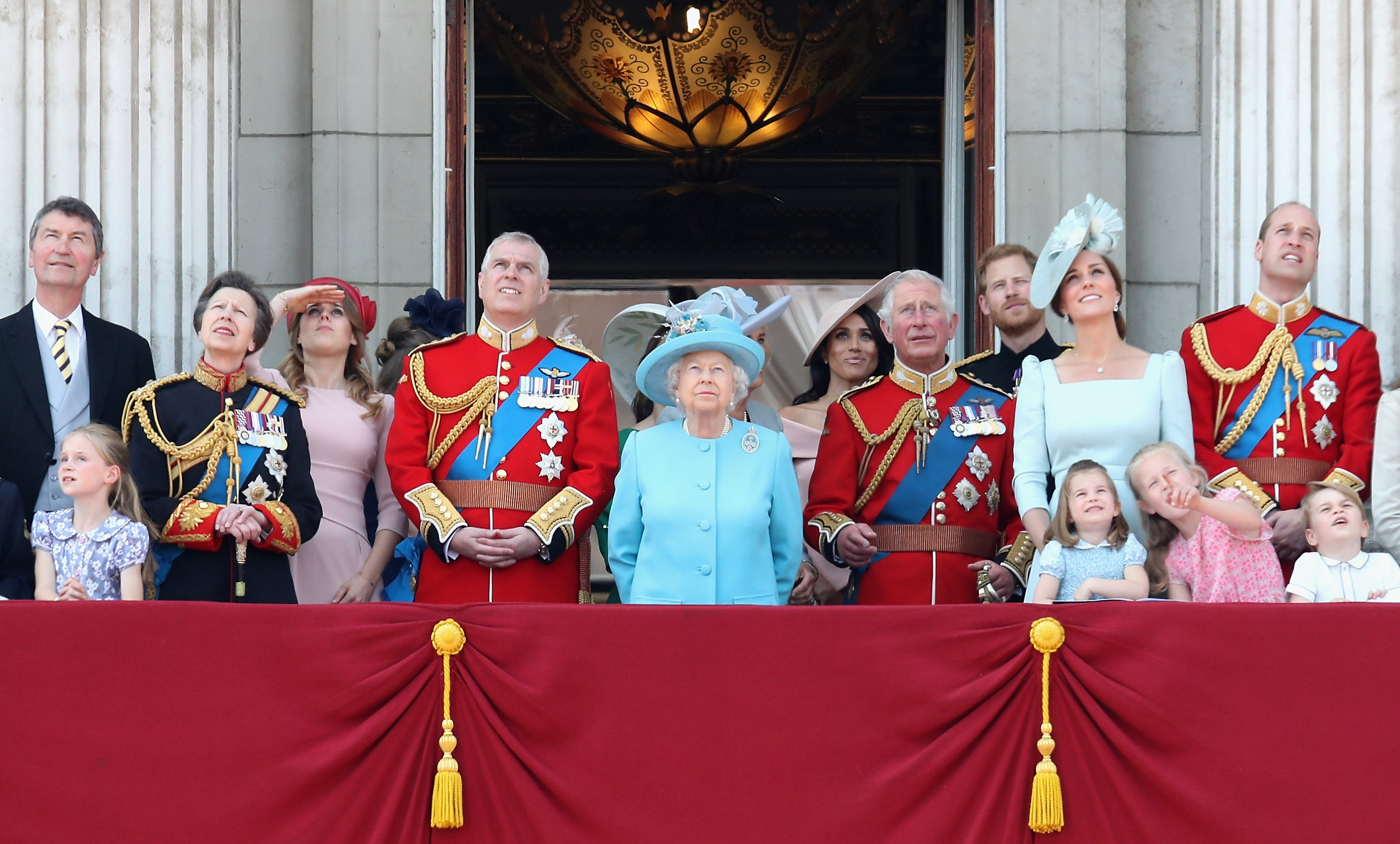 Image Credits: Getty Images / Chris Jackson   Princess Anne, Princess Royal, Princess Beatrice, Lady Louise Windsor, Prince Andrew, Duke of York, Queen Elizabeth II, Meghan, Duchess of Sussex, Prince Charles, Prince of Wales, Prince Harry, Duke of Sussex, Catherine, Duchess of Cambridge, Prince William, Duke of Cambridge, Princess Charlotte of Cambridge, Savannah Phillips, Prince George of Cambridge and Isla Phillips watch the flypast on the balcony of Buckingham Palace during Trooping The Colour on June 9, 2018 in London, England. The annual ceremony involving over 1400 guardsmen and cavalry, is believed to have first been performed during the reign of King Charles II. The parade marks the official birthday of the Sovereign, even though the Queen's actual birthday is on April 21st.