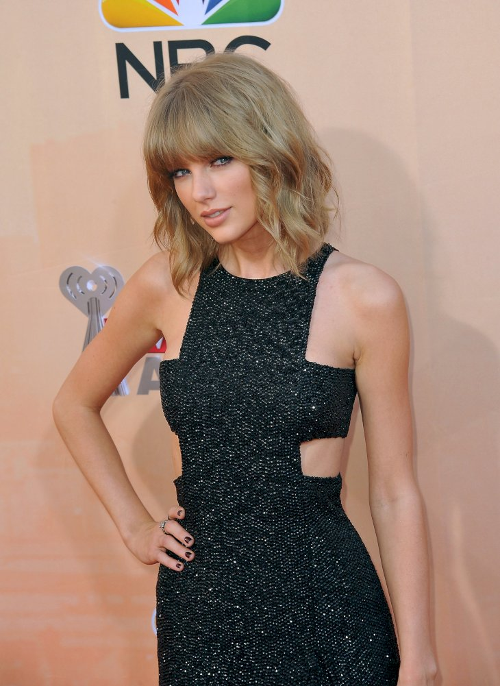 Image Credits: Shutterstock / Featureflash Photo Agency | Taylor Swift at the 2015 iHeart Radio Music Awards at the Shrine Auditorium.