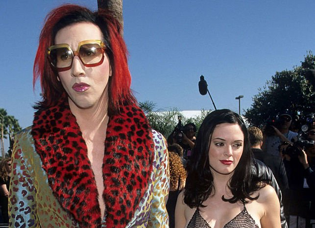 Image Credit: Getty Images / Marilyn Manson and girlfriend actress Rose Mac Gowan arrive at the MTV music awards in 1998.