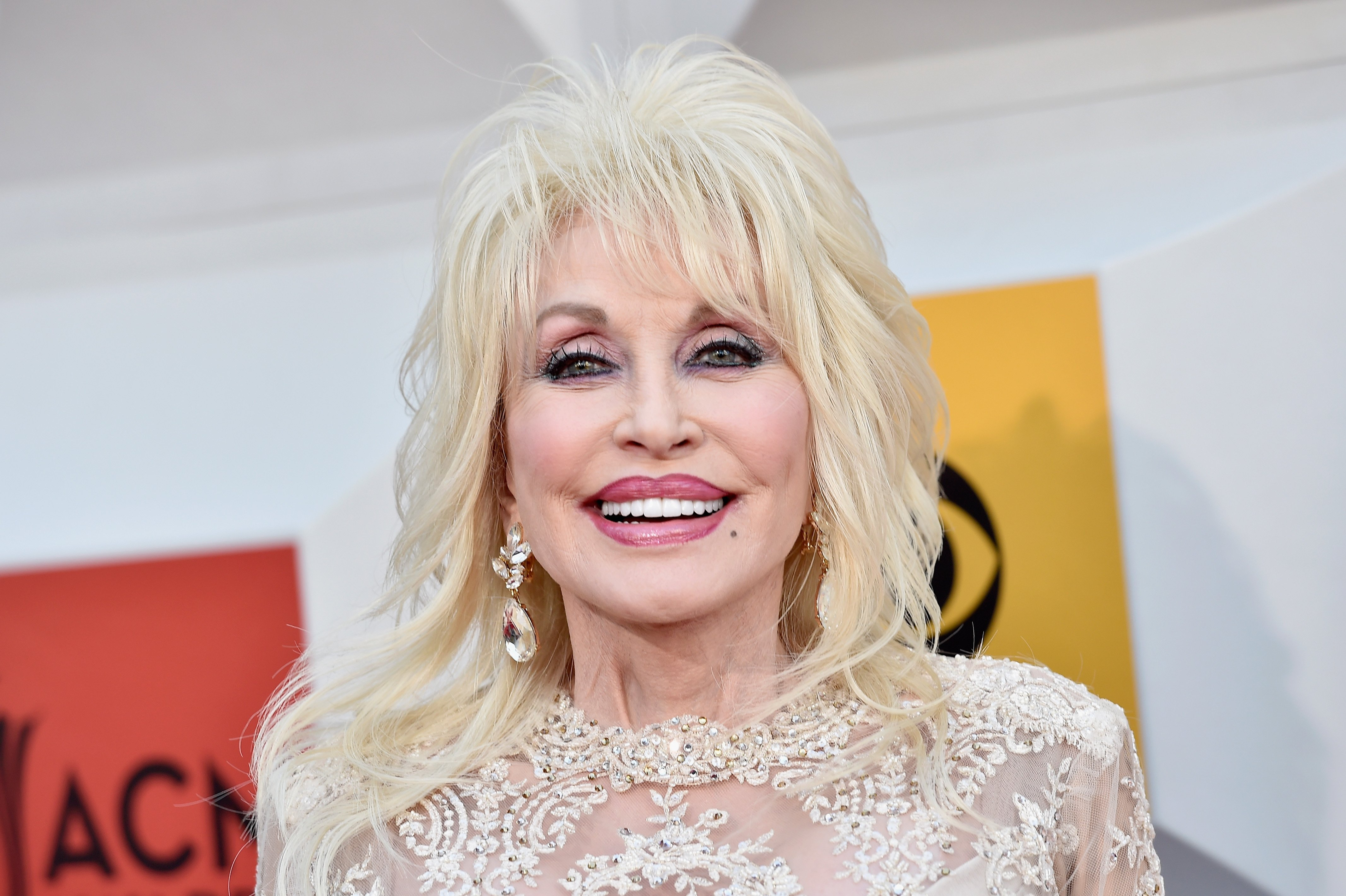 Image Credits: Getty Images / David Becker | Singer-songwriter Dolly Parton attends the 51st Academy of Country Music Awards at MGM Grand Garden Arena on April 3, 2016 in Las Vegas, Nevada.