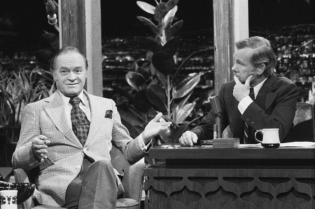 Image Credits: Getty Images / Gary Null / NBCU Photo Bank / NBCUniversal | Comedian Bob Hope, host Johnny Carson.