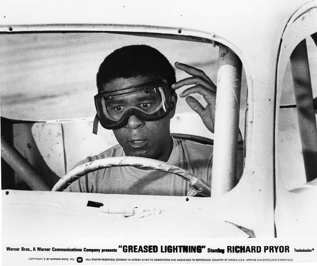 "Image Credits: Getty Images / Michael Ochs Archives | Richard Pryor in a scene from the movie ""Greased Lightning"""