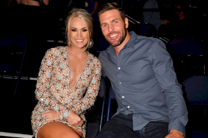 Image Credit: Getty Images/FilmMagic for CMT/Jeff Kravitz | Carrie Underwood and Mike Fisher at the CMT Awards