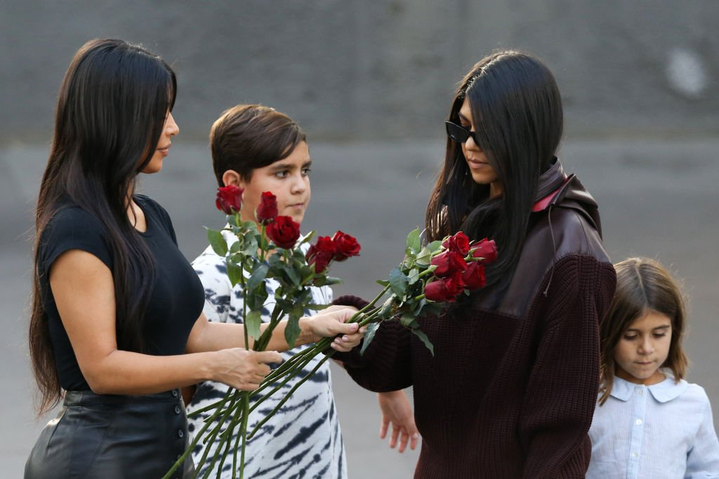 Image Credit: Getty Images / Kim Kardashian and Kourtney Kardashian with Kourtney's children Mason and Penelope Disick at the Armenian Genocide Memorial Complex.